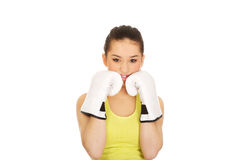 Fitness woman wearing boxing gloves. Royalty Free Stock Images