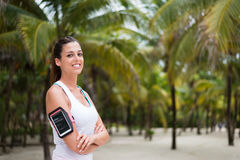 Fitness woman wearing smartphone armband at the beach Royalty Free Stock Photography