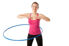 Fitness woman working with hula hoop smiling Stock Photos