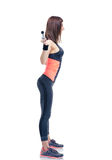 Fitness woman working out with barbell. Side view portrait of a fitness woman working out with barbell isolated on a white background Royalty Free Stock Photography
