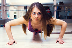 Fitness woman working out Stock Images