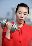 Fitness woman working out with dumbbell Royalty Free Stock Photo