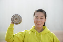 Fitness woman working out with dumbbell Royalty Free Stock Image