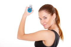 Fitness woman working out with dumbbells Stock Images