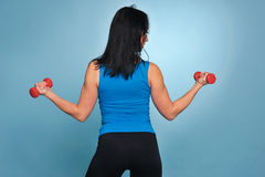 Fitness woman working out with dumbbells. Royalty Free Stock Photos
