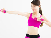 Fitness woman working out with dumbbells Royalty Free Stock Images