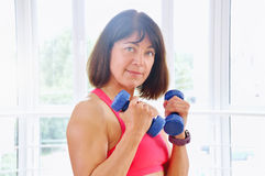 Fitness woman working out with dumbbells Royalty Free Stock Photography