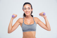Fitness woman working out with dumbbells Stock Photo