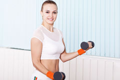 Fitness woman working out with free weights Stock Photos