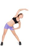 Fitness woman working out gymnastic exercises. Young fitness woman working out gymnastic exercises isolated in white Royalty Free Stock Photos