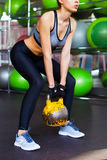 Fitness woman working out with kettle bell Royalty Free Stock Photos