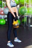 Fitness woman working out with kettle bell Stock Photos