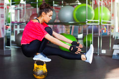 Fitness woman working out with kettle bell Royalty Free Stock Image