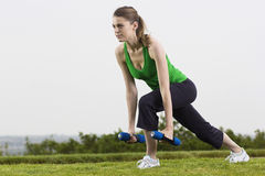 Fitness woman working out outdoors Royalty Free Stock Photos