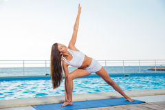 Fitness woman working out outdoors Royalty Free Stock Photo