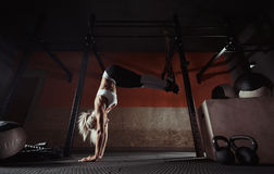 Fitness woman workout on the TRX in the gym Royalty Free Stock Photography
