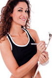 Fitness woman writing on a clip board Stock Photo
