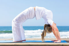 Fitness woman yoga beach Stock Photography