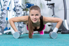Fitness Woman. Young beautiful girl doing sport exercises in the gym Stock Photo