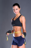 Fitness womans beautiful body with measure tape Stock Image