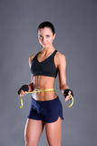 Fitness womans beautiful body with measure tape Stock Photos