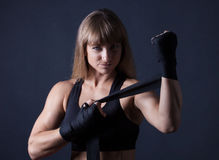 Fitness women applies bandages Stock Image