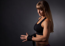 Fitness women applies bandages Stock Images