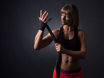 Fitness women applys bandages Royalty Free Stock Images