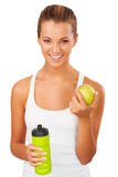 Fitness women with bottle and apple Royalty Free Stock Images