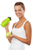 Fitness women with bottle and apple Royalty Free Stock Photography