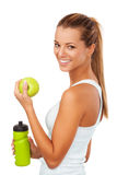 Fitness women with bottle and apple Stock Photography