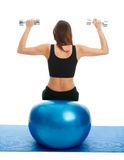 Fitness women doing weightlifting on fitness ball Stock Images