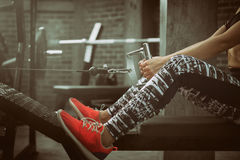 Fitness women exercise with exercise-machine Cable Crossover in gym. Royalty Free Stock Photo