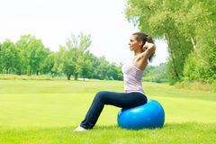 Fitness women exercising outdoors Royalty Free Stock Photos