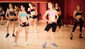Fitness women practicing zumba movements royalty free stock photography
