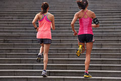 Fitness women running steps royalty free stock photography