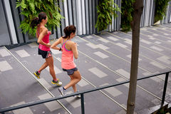 Fitness women running steps Royalty Free Stock Photos
