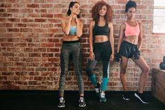 Fitness women standing in gym Stock Photos