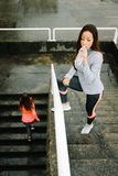 Fitness women working out under the rain Royalty Free Stock Image
