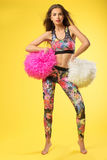 Fitness women on the yellow background. royalty free stock photo