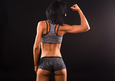 Fitness womna posing in studio Stock Photography
