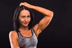 Fitness womna posing in studio Royalty Free Stock Image