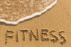 Fitness - word drawn on the sand beach Royalty Free Stock Images