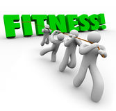 Fitness Word Team Exercising Pulling Together Physical Strength. Fitness word in green 3d letters pulled by a team working together to exercise and gain physical Stock Photo