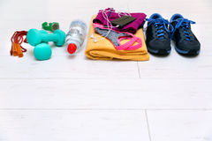 Fitness workout equipment on gym floor with copy space Royalty Free Stock Photography