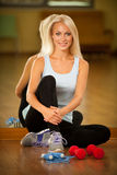 Fitness workout - fit woman training with dumbellc in gym Stock Photo