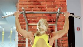 Fitness workout, healthy strong body beautiful young woman, female bodybuilder champion athlete gym, girl performs a. Pulling up exercise, exercises on stock video footage