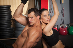 Fitness workout man and woman in a gym Stock Photos