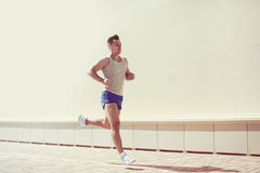 Fitness, workout, sport, lifestyle concept - man running Royalty Free Stock Photography