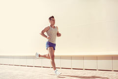 Fitness, workout, sport, lifestyle concept - sportsman running in a city stock image